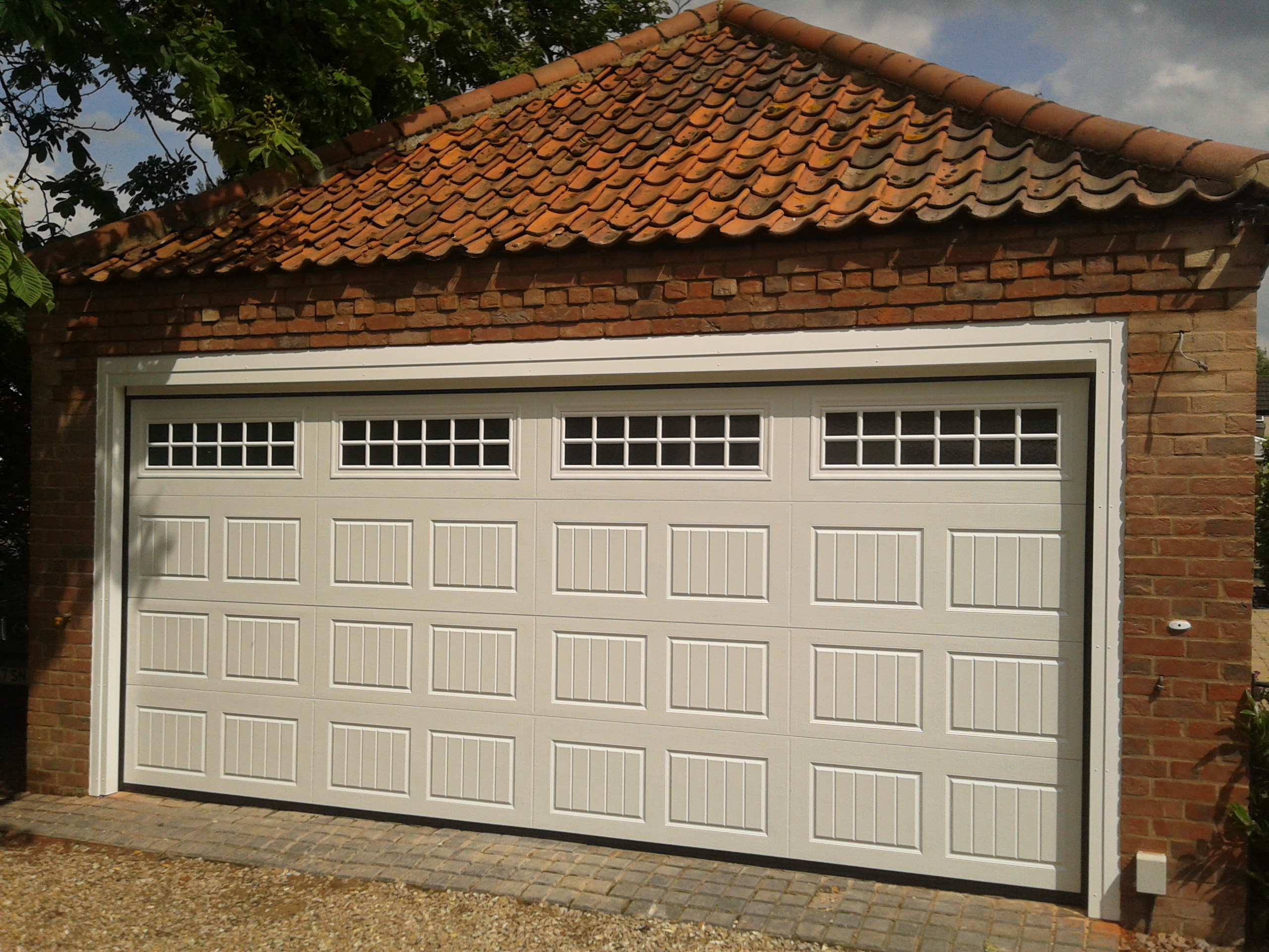 Double automatic garage door garage door company grantham for Two door garage