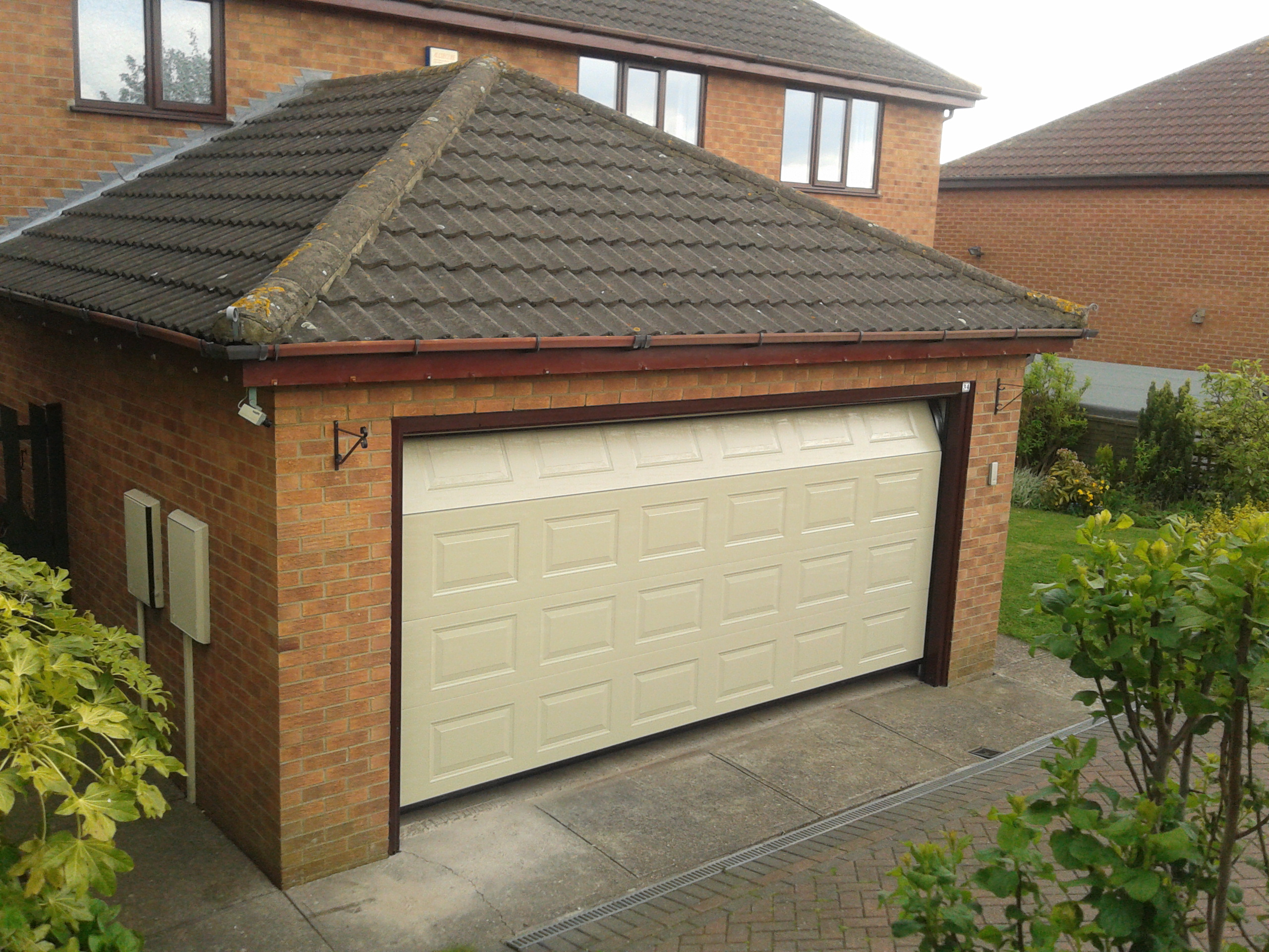 Double garage door mushroom sectional garage door for Two door garage