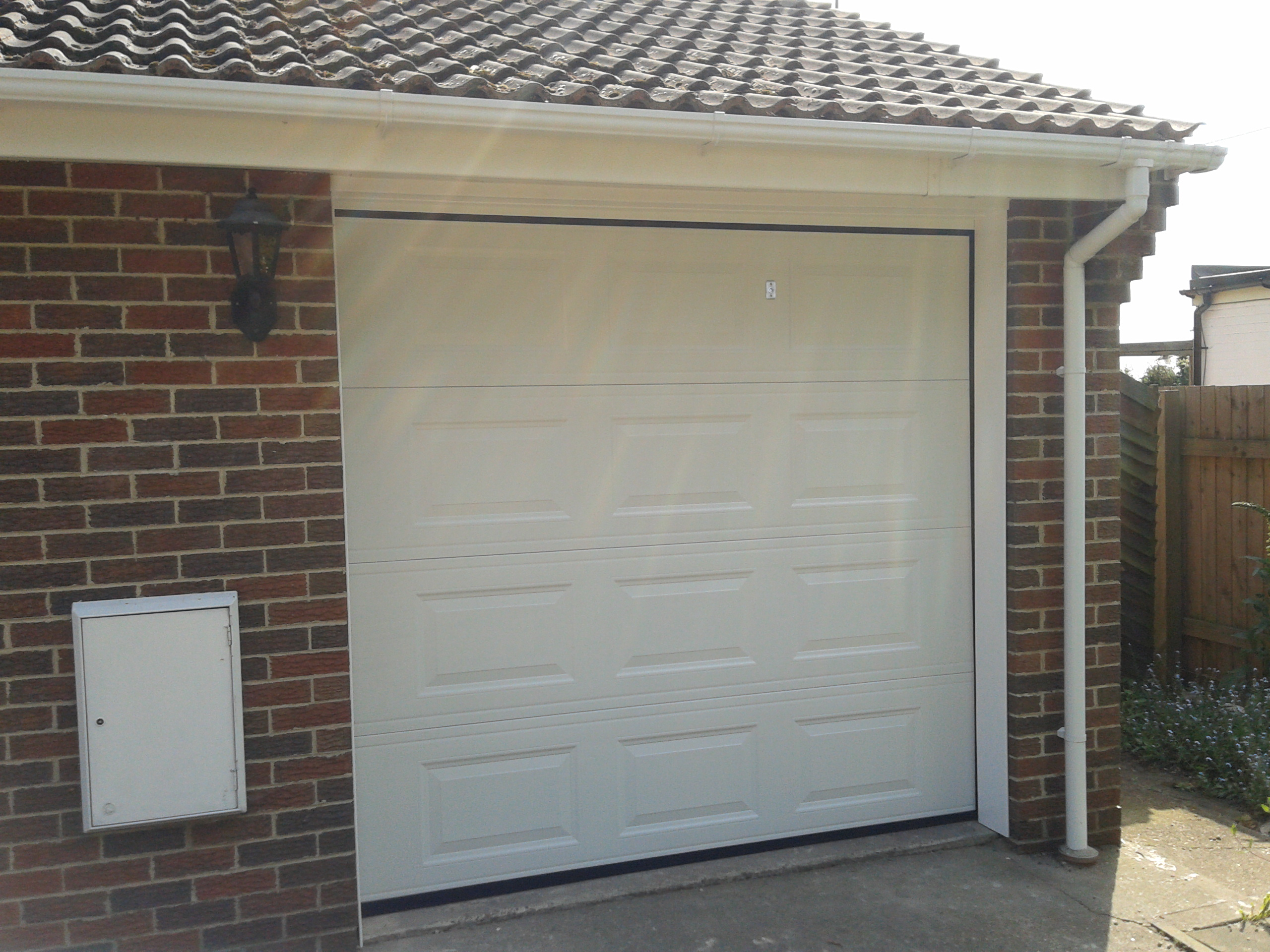Automatic sectional garage door perfect upvc finish for Single garage