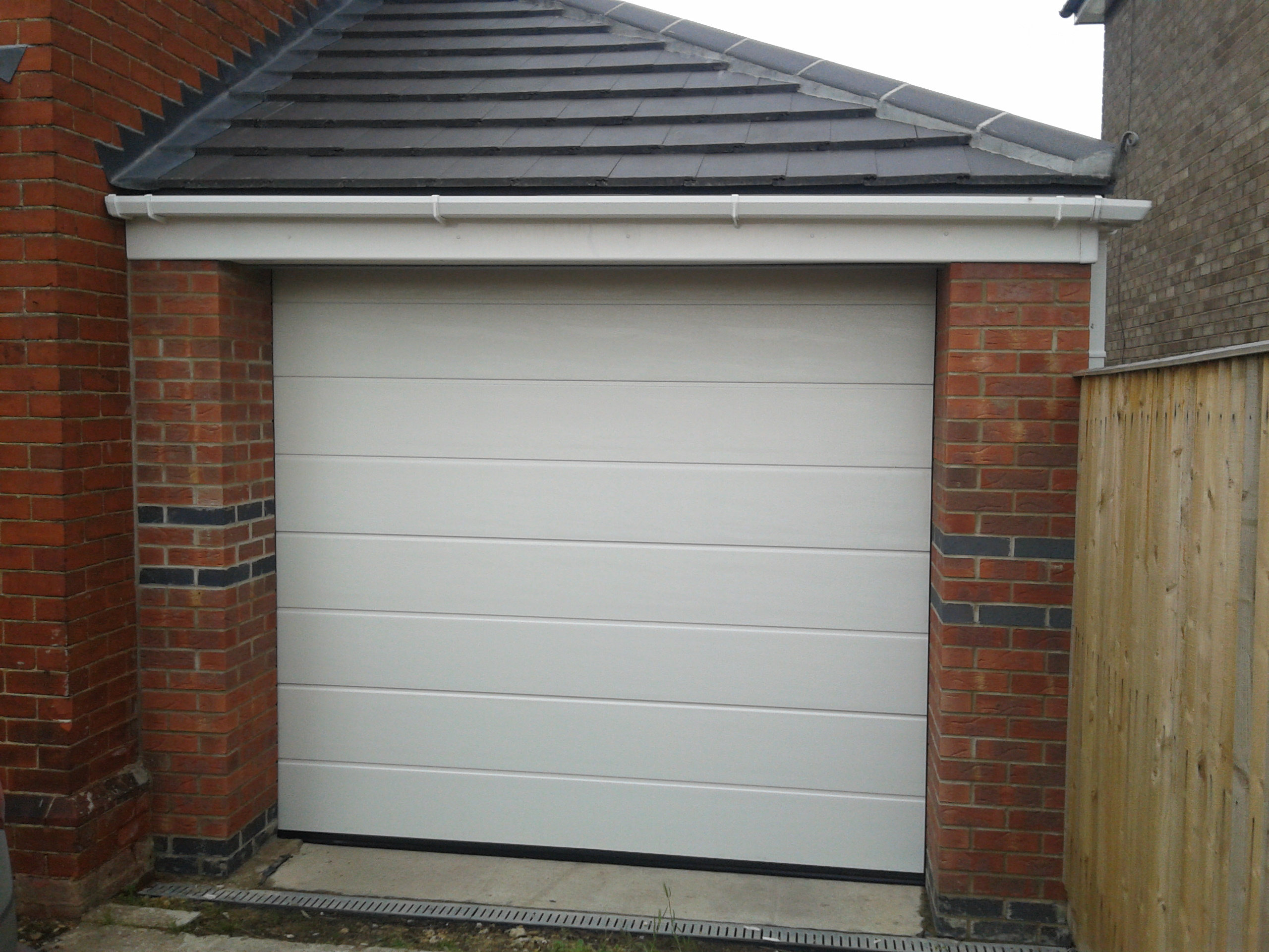 Mrib sectional automatic garage door garage door company for Garage doors uk