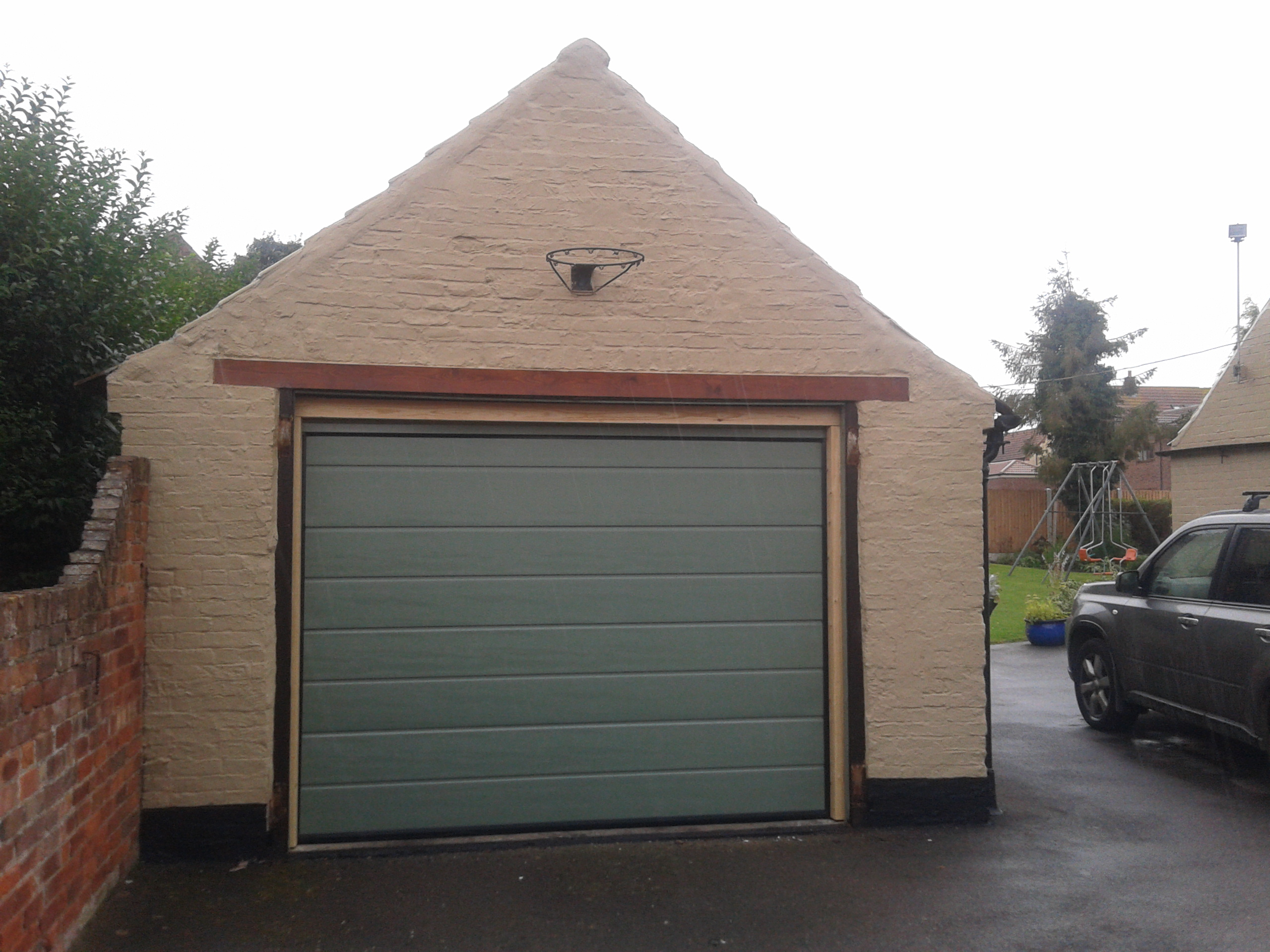 Custom colour automatic sectional garage door garage for Garage doors uk
