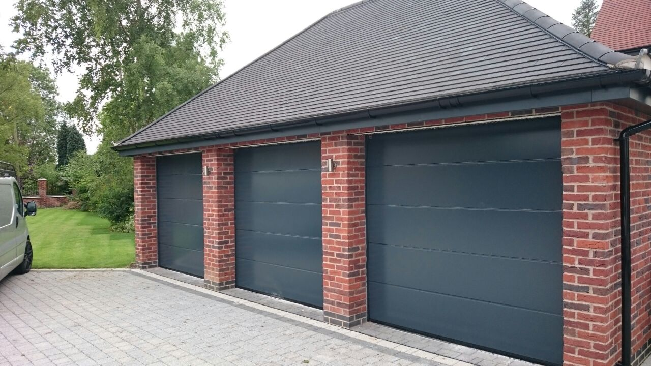 Sectional garage doors garage door company grantham for Sectional glass garage door